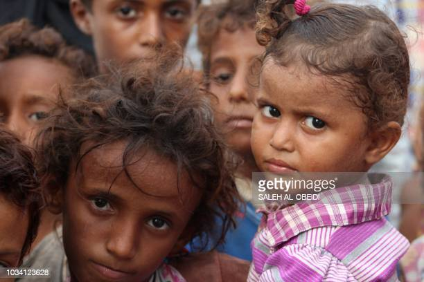 Displaced Yemeni children look on in a camp set up for people who fled the battle areas east of the port city of Hodeida on September 15 2018 Since...