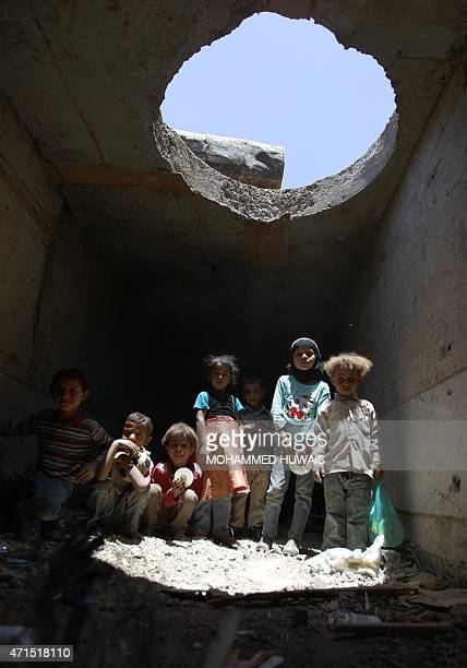Displaced Yemeni children play in a man made underground water tunnel where they are taking shelter after their houses were destroyed by air strikes...