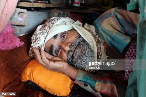 A displaced Yemeni man who fled the fighting between the Saudiled coalition and Shiite Huthi rebels in the area of Harad rests in the shade at a camp...