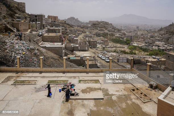 A OUTSKIRTS SANA Displaced Yemeni women wash clothes on the roof of their new home in the hills on the outskirts of the Yemeni capital of Sana'a The...