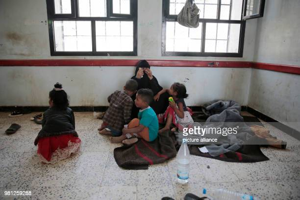 Displaced Yemenis who fled their homes in the wartorn port city of Al Hudaydah rest after arriving in Sanaa as clashes intensify in western coast...
