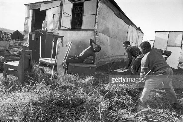 Displacement of population in South Africa in 1989 Children clean a ground following a displacement from Soweto to Orange Farm