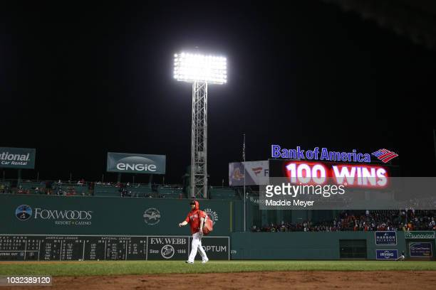 A display board over the bleacher section celebrates the Boston Red Sox 100th win of the season after the Sox defeat the Toronto Blue Jays 10 at...