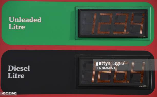 A display board showing the price of unleaded and diesel fuels is pictured at a supermarket service station in Tonbridge south east of London on...