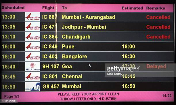 Display board showing the status as cancelled of many Air India flights at the Indira Gandhi International Airport in New Delhi on Sunday, September...