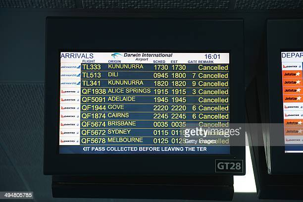 A display board shows cancelled flights in Darwin airport on May 31 2014 in Darwin Australia Flights in and out of Darwin have been suspended as...