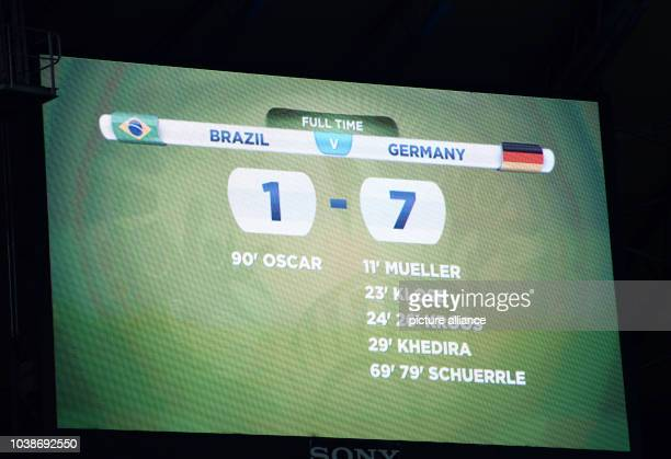 Display board shows the result as Germany thrashed Brazil with 1-7 after the FIFA World Cup 2014 semi-final soccer match between Brazil and Germany...