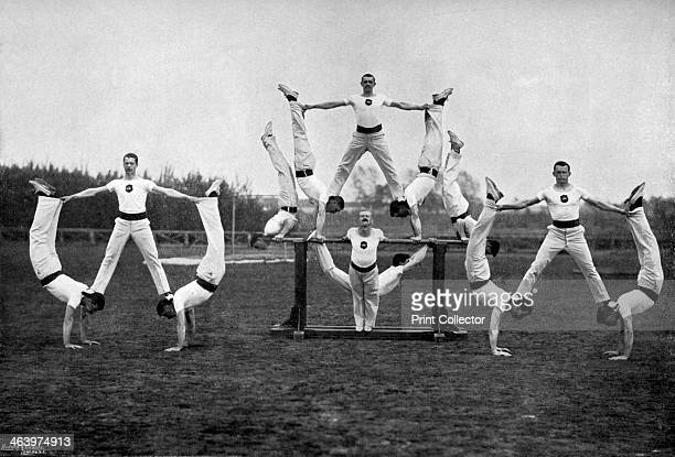 Display by the Aldershot gymnastic staff, Hampshire, 1896. A print from The Navy and Army Illustrated, 31st January 1896.