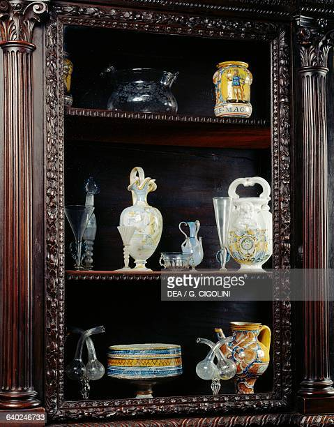 Display cabinet with glass and ceramic objects dining room Bagatti Valsecchi museum Milan Lombardy Italy