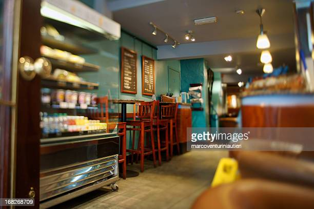 display case and furniture in interior of cafe - convenience store stock photos and pictures