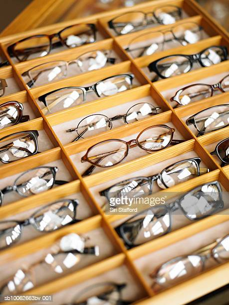 display case of eyeglasses, close-up, high angle view - めがね類 ストックフォトと画像
