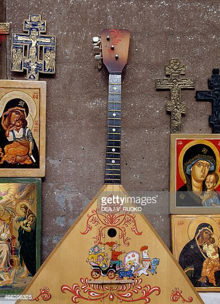 Display case with sacred images crucifixes and a balalaika Moscow Russia