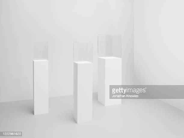 display cases on white plinths - art gallery stock pictures, royalty-free photos & images