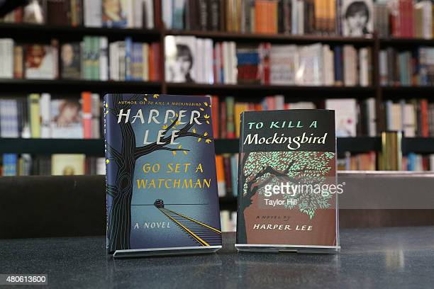 A display copy of Go Set a Watchman the first published novel by author Harper Lee in 55 years sits sidebyside with a display copy of To Kill a...