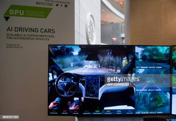 A display demonstrates the sensors and technology behind selfdriving cars during the NVIDIA GPU Technology Conference which showcases artificial...