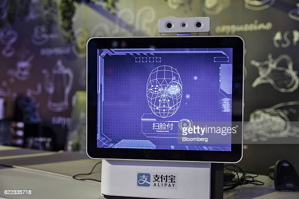 A display demonstrating a facial recognition system for Ant Financial Services Group's Alipay mobile payment platform stands on display at Alibaba...