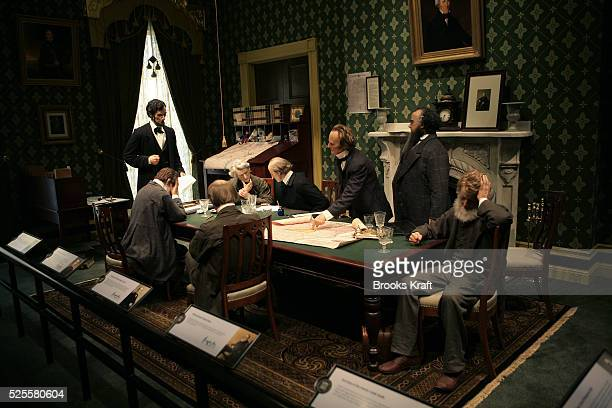 A display depicting a meeting with of President Abraham Lincoln's cabinet in which he read a draft of the Emancipation Proclamation inside the...
