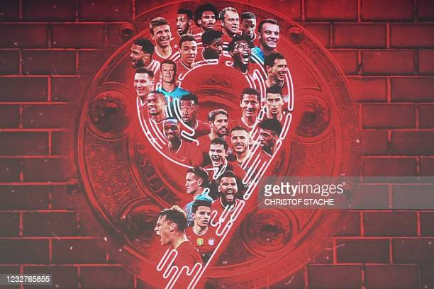 Display featuring the players, the trophy and the number 9 is seen prior to the German first division Bundesliga football match FC Bayern Munich v...