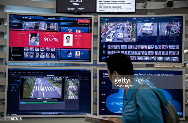 A display for facial recognition and artificial intelligence is seen on monitors at Huawei's Bantian campus on April 26 2019 in Shenzhen China Huawei...