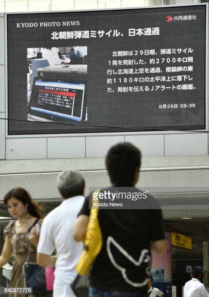 A display near JR Osaka Station reports on the Aug 29 launch of a North Korean ballistic missile that fell into the Pacific Ocean off Japan's...