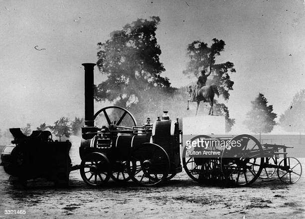 A display of a portable steam engine corn threshing machine and a seed drill on show at the Great Exhibition Crystal Palace Hyde Park in London
