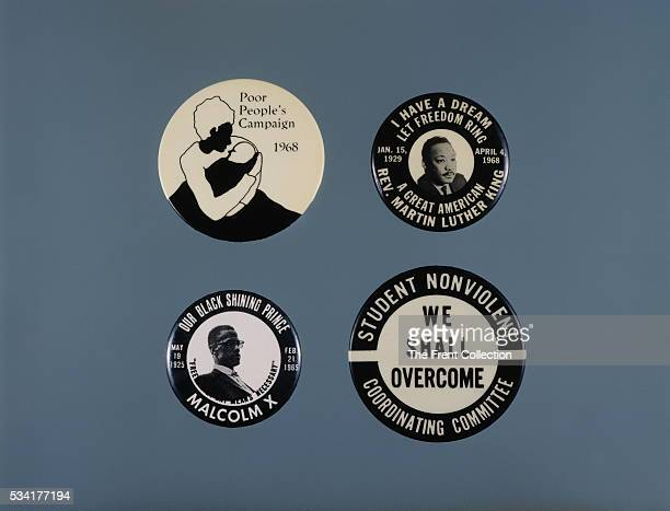 A display of black and white buttons that include the 'Poor People's Campaign' a Martin Luther King 'I Have a Dream' a Malcom X 'Our Black Shining...