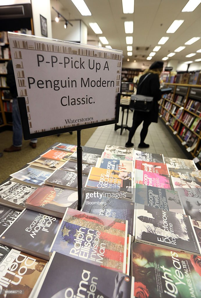A display of books published by the Penguin publishing house, part of Pearson Plc, is seen at a bookstore in London, U.K., on Friday, April 5, 2013. Bertelsmann SE's Random House won European Union approval to buy Pearson Plc's Penguin unit to create the largest book publisher in the U.K. and the U.S. Photographer: Chris Ratcliffe/Bloomberg via Getty Images