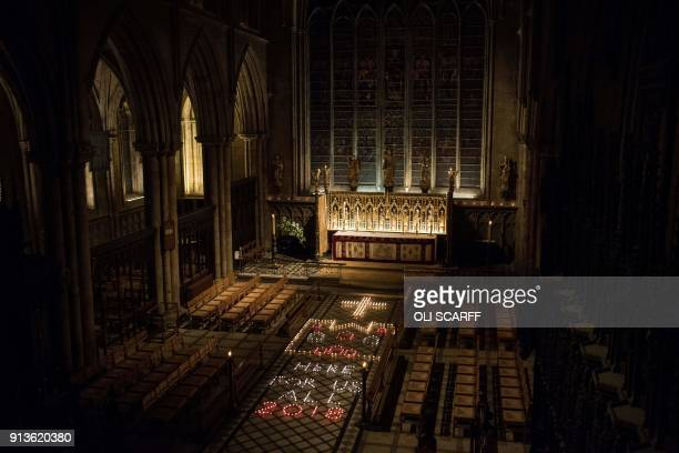 A display of candles is lit prior to the Candlemas Festal Eucharist service at Ripon Cathedral in Ripon northern England on February 2 2018 The...