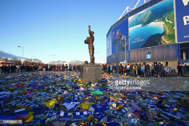 Display of Cardiff City scarves and jerseys, flowers, messages and other tributes to the football club's new signing Emiliano Sala, whose flight...