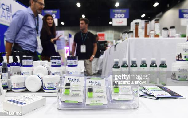 A display of CBD infused foot cream vape pods and massage oil products from Medical Mary are viewed at the 6th Annual Cannabis World Congress and...