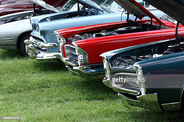 Display of classic automobiles at Indiana car show.  Colorful.  Summer.