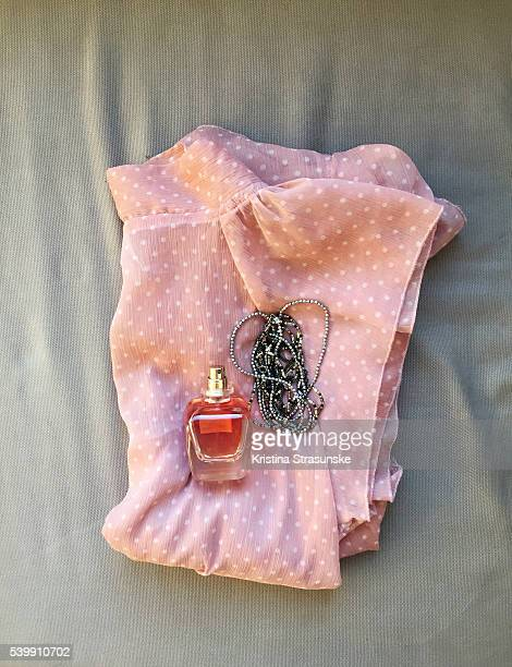 display of feminine everyday items clothign and accessories