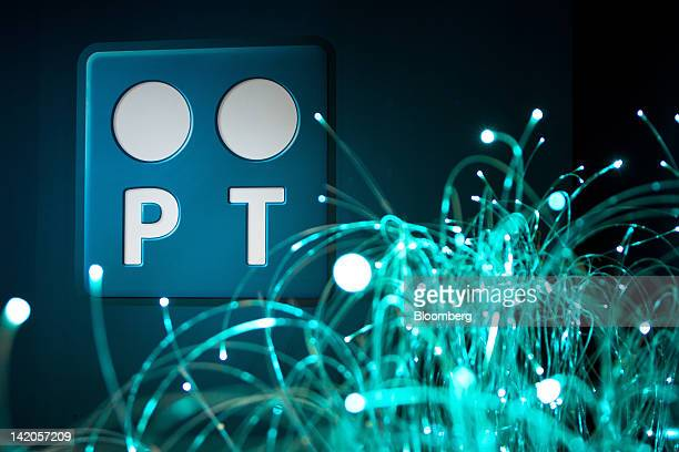 A display of fibre optic cable is seen near a logo inside the headquarters of Portugal Telecom SGPS SA in Lisbon Portugal on Thursday March 29 2012...