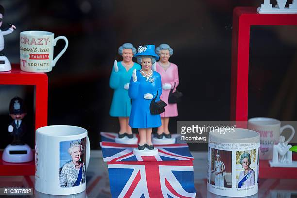 A display of figurines of Her Majesty The Queen of England are seen in the window of a souvenir shop in London UK on Monday Feb 15 2016 UK lawmakers...
