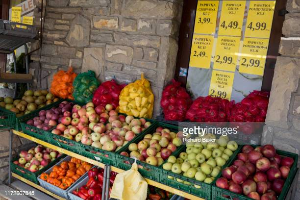 A display of fresh fruit mainly apples paprikas and peppers outside a small Polish supermarket on 21st September 2019 in Szczawnica Malopolska Poland