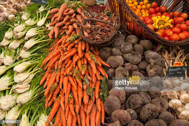 Display of fresh vegetables on market stall, Issigeac, France
