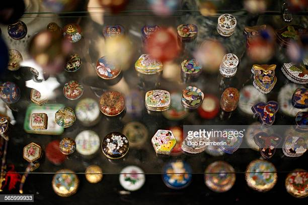 Display of little cloisonne enamel pill boxes at Hong Kong Imports in Los Angeles' Chinatown which offers a wide variety of gifts from trendy new...