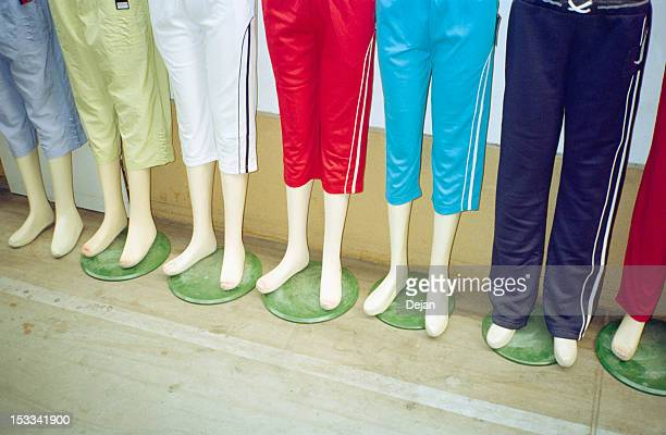 display of mannequins wearing tracksuit shorts - running shorts stock pictures, royalty-free photos & images