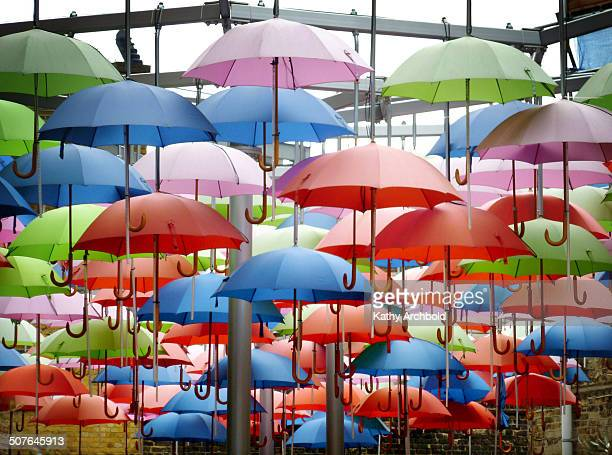 Display of multi coloured umbrellas outside a restaurant in Borough Market, London.
