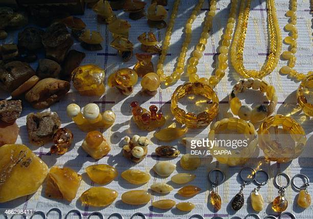 Display of necklaces bracelets key rings and amber crystals Lithuania