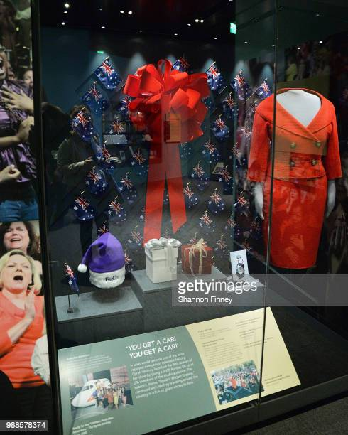 A display of objects from the car giveaway episode of The Oprah Winfrey Show including the red suit worn by Ms Winfrey at the exhibition Watching...