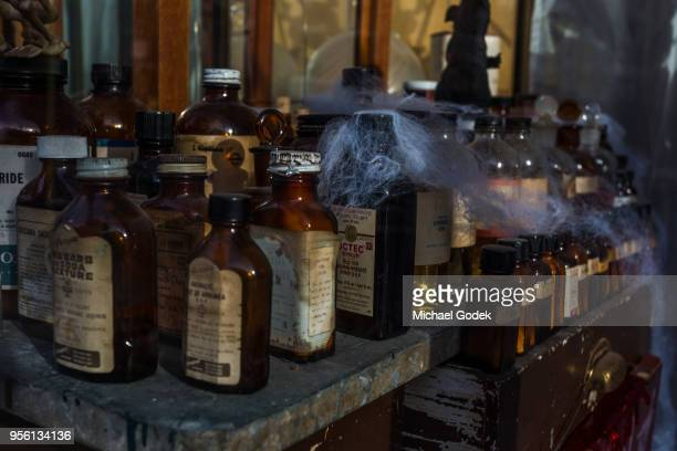 display of old apothecary bottles - potion stock photos and pictures