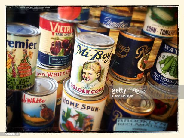 Display of old food cans with vintage labels in antique store