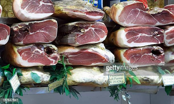 display of parma hams - parma stock photos and pictures