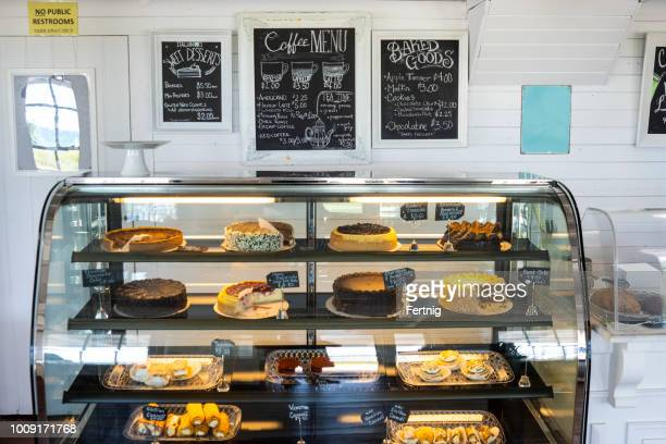 a display of pastries in a cafe - bakery stock pictures, royalty-free photos & images