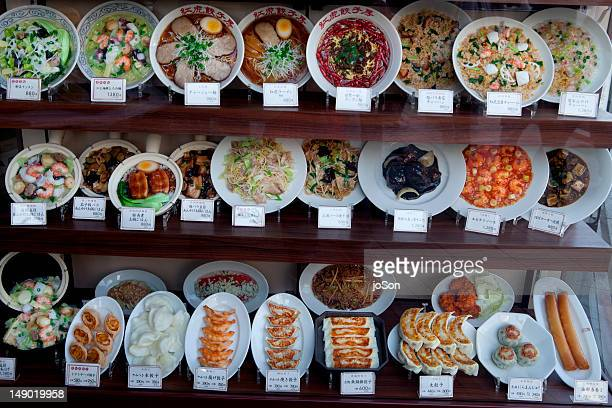 Display of plastic food in front of restaurant