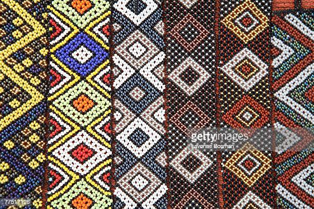 Display of Rows of Brightly Coloured African Traditional Beaded Wristbands . Cape Town, Western Cape Province, South Africa