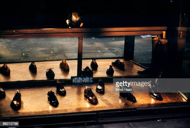 A display of shoes with the sign 'Public Notary' in New York circa 1960