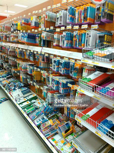 display of stationery on shelf in supermarket - office supply stock photos and pictures