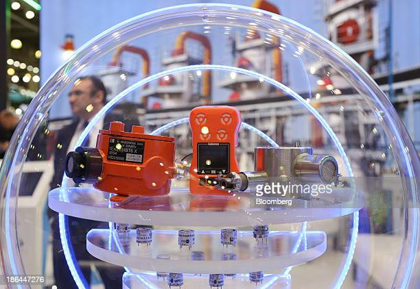 Display of technology including infrared optical gas sensors for the detection of methane and hydrocarbons, below, sits on the OAO Rusnano pavilion...
